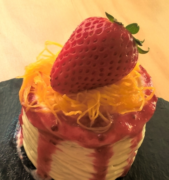 Butter cake with whipped cream strawberries and egg threads