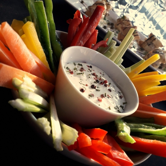 Assorted vegetable strips with cheese and yogurt sauce
